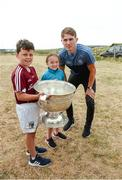 10 July 2018; Michael Fitzsimons of Dublin with Liam Conneely, aged 9, from Barna, Co. Galway, and Leah Conneely, aged 9, from Glen, Co. Wexford, during a visit to Aran Islands GAA club prior to the GAA Hurling and Football All Ireland Senior Championship Series National Launch at the Aran Islands, Co Galway. Photo by Diarmuid Greene/Sportsfile