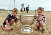 10 July 2018; Brothers Eoghan Quinn, aged 6, left, and Cathal Quinn, aged 3, with the Sam Maguire cup during a visit to Aran Islands GAA club prior to the GAA Hurling and Football All Ireland Senior Championship Series National Launch at the Aran Islands, Co Galway. Photo by Diarmuid Greene/Sportsfile