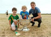 10 July 2018; Michael Fitzsimons of Dublin with Cillian O'Moran, aged 8, and Eoghan Ó Moran, aged 2, and the Sam Maguire cup during a visit to Aran Islands GAA club prior to the GAA Hurling and Football All Ireland Senior Championship Series National Launch at the Aran Islands, Co Galway.   Photo by Diarmuid Greene/Sportsfile
