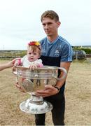10 July 2018; Michael Fitzsimons of Dublin with Lisa Conneely, aged 10 months, during a visit to Aran Islands GAA club prior to the GAA Hurling and Football All Ireland Senior Championship Series National Launch at the Aran Islands, Co Galway. Photo by Diarmuid Greene/Sportsfile