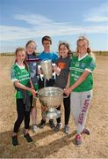10 July 2018; Jessica Boland, Grace Rodgers, Shane Dirrane, Lauren Rodgers, and Cleonna Dillane, from Inis Mór, Co. Galway, with the Sam Maguire and Liam Mac Carthy cups during a visit to Aran Islands GAA club prior to the GAA Hurling and Football All Ireland Senior Championship Series National Launch at the Aran Islands, Co Galway. Photo by Diarmuid Greene/Sportsfile