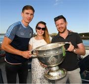 10 July 2018; Colm Burke, from Celbridge, Co Kildare, and his girlfriend Justina Mucya, from Poland, to whom Colm proposed during a visit to the Aran Islands, with Michael Fitzsimons of Dublin and the Sam Maguire Cup before the GAA Hurling and Football All Ireland Senior Championship Series National Launch at Dun Aengus in the Aran Islands, Co Galway. Photo by Ray McManus/Sportsfile