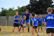 12 July 2018; Josh van der Flier of Leinster with camp participants during the Bank of Ireland Leinster Rugby Summer Camp - Greystones RFC at Greystones RFC in Greystones, Co Wicklow. Photo by Brendan Moran/Sportsfile