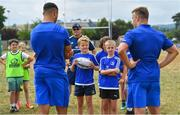12 July 2018; Leinster players Adam Byrne and Josh van der Flier with camp participants during the Bank of Ireland Leinster Rugby Summer Camp - Greystones RFC at Greystones RFC in Greystones, Co Wicklow. Photo by Brendan Moran/Sportsfile