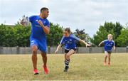 12 July 2018; Adam Byrne of Leinster with camp participants during the Bank of Ireland Leinster Rugby Summer Camp - Greystones RFC at Greystones RFC in Greystones, Co Wicklow. Photo by Brendan Moran/Sportsfile