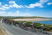 12 July 2018; Race Leader Magnus Sheffield, Hot Tubes, leads the peloton as the race passes through Lahinch during Stage Three of the Eurocycles Eurobaby Junior Tour 2018, Ennis, Co. Clare. Photo by Stephen McMahon/Sportsfile