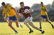 13 July 2018; Conor Raftery of Galway in action against Shane Cunnane of Roscommon during the Electric Ireland Connacht GAA Minor Championship Final match between Roscommon and Galway at Dr Hyde Park in Roscommon. Photo by Matt Browne/Sportsfile