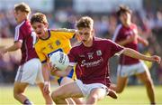 13 July 2018; Matthew Cooley of Galway in action against Robbie Dolan of Roscommon during the Electric Ireland Connacht GAA Minor Championship Final match between Roscommon and Galway at Dr Hyde Park in Roscommon. Photo by Matt Browne/Sportsfile