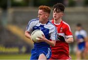 13 July 2018; Ronan Grimes of Monaghan in action against Conleth McGuckian of Derry during the Electric Ireland Ulster GAA Football Minor Championship Final match between Derry and Monaghan at the Athletic Grounds, Armagh. Photo by Oliver McVeigh/Sportsfile