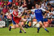 13 July 2018; Ethan Doherty of Derry in action against Breandan Og O'Dufaigh, behind, and Donnach Swinburne of Monaghan during the Electric Ireland Ulster GAA Football Minor Championship Final match between Derry and Monaghan at the Athletic Grounds, Armagh. Photo by Oliver McVeigh/Sportsfile