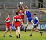 13 July 2018; Sean Jones of Monaghan in action against Jarleth Donaghy of Derry during the Electric Ireland Ulster GAA Football Minor Championship Final match between Derry and Monaghan at the Athletic Grounds, Armagh. Photo by Oliver McVeigh/Sportsfile