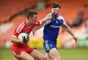 13 July 2018; Shay Murray of Derry in action against Breandan Og O'Dufaigh of Monaghan during the Electric Ireland Ulster GAA Football Minor Championship Final match between Derry and Monaghan at the Athletic Grounds, Armagh. Photo by Oliver McVeigh/Sportsfile