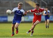 13 July 2018; Jordan McGarrell of Monaghan in action against Shea Murray of Derry during the Electric Ireland Ulster GAA Football Minor Championship Final match between Derry and Monaghan at the Athletic Grounds, Armagh. Photo by Oliver McVeigh/Sportsfile