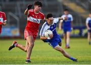 13 July 2018; Donnach Swinburne of Monaghan in action against Iarlaith Donaghy of Derry during the Electric Ireland Ulster GAA Football Minor Championship Final match between Derry and Monaghan at the Athletic Grounds, Armagh. Photo by Oliver McVeigh/Sportsfile