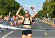 14 July 2018; First female finisher, Caitriona Jennings of Letterkenny AC, crosses the line during the Irish Runner 10 Mile at Phoenix Park in Dublin. Photo by Eoin Smith/Sportsfile