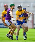 14 July 2018; Tony Kelly of Clare in action against Matthew O'Hanlon and Kevin Foley of Wexford during the GAA Hurling All-Ireland Senior Championship Quarter-Final match between Clare and Wexford at Páirc Ui Chaoimh in Cork. Photo by Brendan Moran/Sportsfile