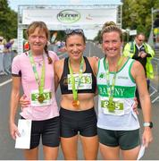 14 July 2018; First female finisher Catriona Jennings of Letterkenny AC, centre, alongside second place Karen Alexander, left, and third place Tara Kennedy after the Irish Runner 10 Mile at Phoenix Park in Dublin. Photo by Eoin Smith/Sportsfile