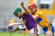 14 July 2018; Shaun Murphy of Wexford in action against John Conlon of Clare during the GAA Hurling All-Ireland Senior Championship Quarter-Final match between Clare and Wexford at Páirc Ui Chaoimh in Cork. Photo by Brendan Moran/Sportsfile