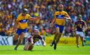 14 July 2018; Paudie Foley of Wexford in action against Cathal Malone and Peter Duggan of Clare during the GAA Hurling All-Ireland Senior Championship Quarter-Final match between Clare and Wexford at Páirc Ui Chaoimh in Cork. Photo by Brendan Moran/Sportsfile