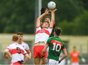14 July 2018; Dara Rafferty of Derry in action against Evan O'Brien of Mayo during the EirGrid GAA Football All-Ireland U20 Championship Semi-Final match between Mayo and Derry at Páirc Seán Mac Diarmada, in Carrick-on-Shannon. Photo by Piaras Ó Mídheach/Sportsfile