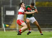 14 July 2018; Tommy Conroy of Mayo in action against Pádraig McGrogan of Derry during the EirGrid GAA Football All-Ireland U20 Championship Semi-Final match between Mayo and Derry at Páirc Seán Mac Diarmada, in Carrick-on-Shannon. Photo by Piaras Ó Mídheach/Sportsfile