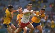 14 July 2018; Niall Sludden of Tyrone in action against Tadhg O'Rourke, right, Conor Devaney and Ciarain Murtagh of Roscommon , left, during the GAA Football All-Ireland Senior Championship Quarter-Final Group 2 Phase 1 match between Tyrone and Roscommon at Croke Park in Dublin. Photo by Ray McManus/Sportsfile