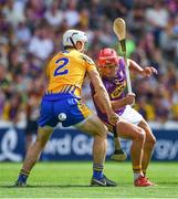 14 July 2018; Lee Chin of Wexford is tackled by Patrick O'Connor of Clare during the GAA Hurling All-Ireland Senior Championship Quarter-Final match between Clare and Wexford at Páirc Ui Chaoimh in Cork. Photo by Brendan Moran/Sportsfile