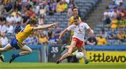 14 July 2018; Niall Sludden of Tyrone kicks a goal, in the 12th minute, under pressure from Cathal Compton of Roscommon during the GAA Football All-Ireland Senior Championship Quarter-Final Group 2 Phase 1 match between Tyrone and Roscommon at Croke Park in Dublin. Photo by Ray McManus/Sportsfile
