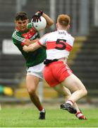 14 July 2018; Tommy Conroy of Mayo in action against Declan Cassidy of Derry during the EirGrid GAA Football All-Ireland U20 Championship Semi-Final match between Mayo and Derry at Páirc Seán Mac Diarmada, in Carrick-on-Shannon. Photo by Piaras Ó Mídheach/Sportsfile