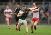 14 July 2018; Conor Diskin of Mayo in action against Pádraig McGrogan of Derry during the EirGrid GAA Football All-Ireland U20 Championship Semi-Final match between Mayo and Derry at Páirc Seán Mac Diarmada, in Carrick-on-Shannon. Photo by Piaras Ó Mídheach/Sportsfile