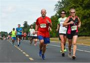 14 July 2018; Ronald Staeps, left, and Ann Gorman Donnelly during the Irish Runner 10 Mile at Phoenix Park in Dublin. Photo by Eoin Smith/Sportsfile