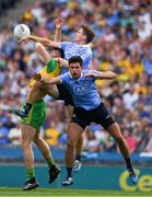 14 July 2018; Odhrán Mac Niallais of Donegal in action against Michael Fitzsimons and Cian O'Sullivan of Dublin during the GAA Football All-Ireland Senior Championship Quarter-Final Group 2 Phase 1 match between Dublin and Donegal at Croke Park in Dublin. Photo by Ray McManus/Sportsfile