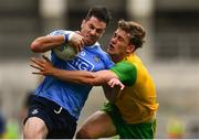 14 July 2018; Michael Darragh Macauley of Dublin in action against Hugh McFadden of Donegal during the GAA Football All-Ireland Senior Championship Quarter-Final Group 2 Phase 1 match between Dublin and Donegal at Croke Park, in Dublin. Photo by David Fitzgerald/Sportsfile