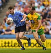 14 July 2018; Jack McCaffrey of Dublin in action against Neil McGee of Donegal  during the GAA Football All-Ireland Senior Championship Quarter-Final Group 2 Phase 1 match between Dublin and Donegal at Croke Park in Dublin. Photo by Ray McManus/Sportsfile