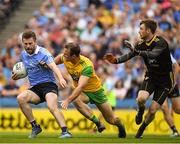 14 July 2018; Jack McCaffrey of Dublin  in action against Neil McGee and goalkeeper Shaun Patton of Donegal  during the GAA Football All-Ireland Senior Championship Quarter-Final Group 2 Phase 1 match between Dublin and Donegal at Croke Park in Dublin.  Photo by Ray McManus/Sportsfile