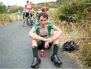 14 July 2018; Conor Gallagher of Ireland National Team, recovers after the finish of the Eurocycles Eurobaby Junior Tour of Ireland 2018 - Stage Five, Ennis to Gallows Hill. Photo by Stephen McMahon/Sportsfile