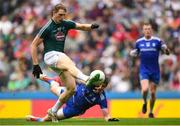 15 July 2018; Daniel Flynn of Kildare shoots to score his side's first goal despite the attempted tackle from Darren Hughes of Monaghan during the GAA Football All-Ireland Senior Championship Quarter-Final Group 1 Phase 1 match between Kildare and Monaghan at Croke Park, Dublin. Photo by David Fitzgerald/Sportsfile