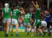 15 July 2018; Limerick players celebrate as referee James McGrath signals the final whistle of the GAA Hurling All-Ireland Senior Championship Quarter-Final match between Kilkenny and Limerick at Semple Stadium, Thurles, Co Tipperary. Photo by Ray McManus/Sportsfile