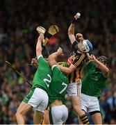 15 July 2018; TJ Reid of Kilkenny in action against Sean Finn, Dan Morrissey, 7, and Diarmaid Byrnes of Limerick  during the GAA Hurling All-Ireland Senior Championship Quarter-Final match between Kilkenny and Limerick at Semple Stadium, Thurles, Co Tipperary. Photo by Ray McManus/Sportsfile
