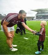 15 July 2018; Galway captain Damien Comer gives his gloves to young Galway supporter Rian Sheridan, age 4, after the GAA Football All-Ireland Senior Championship Quarter-Final Group 1 Phase 1 match between Kerry and Galway at Croke Park, Dublin. Photo by David Fitzgerald/Sportsfile