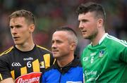 15 July 2018; Referee James McGrath stands between Kilkenny captain Cillian Buckley and Emmet McEvoy before the GAA Hurling All-Ireland Senior Championship Quarter-Final match between Kilkenny and Limerick at Semple Stadium, Thurles, Co Tipperary Photo by Ray McManus/Sportsfile