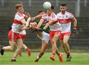 14 July 2018; Colm Moran of Mayo shoots under pressure from Declan Cassidy, left, and Shea Downey of Derry during the EirGrid GAA Football All-Ireland U20 Championship Semi-Final match between Mayo and Derry at Páirc Seán Mac Diarmada, in Carrick-on-Shannon. Photo by Piaras Ó Mídheach/Sportsfile