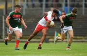 14 July 2018; Caullm Brown of Derry in action against Jordan Flynn, left, and Brian O'Malley during the EirGrid GAA Football All-Ireland U20 Championship Semi-Final match between Mayo and Derry at Páirc Seán Mac Diarmada, in Carrick-on-Shannon. Photo by Piaras Ó Mídheach/Sportsfile