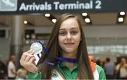 16 July 2018; Ireland's Sommer Lecky of Finn Valley AC, Co Donegal, with her silver medal she won in the women's high jump event during the Team Ireland homecoming from the IAAF World U20 Athletics Championships in Tampere, Finland, at Dublin Airport in Dublin. Photo by Piaras Ó Mídheach/Sportsfile