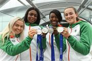 16 July 2018; Ireland's silver medal winners in the women's 4x100m relay team event, from left, Molly Scott of St Laurence O'Toole AC, Co Carlow, Patience Jumbo-Gula of St Gerard's AC, Dundalk, Co Louth, Gina Akpe-Moses of Blackrock AC, Co Louth, and Ciara Neville of Emerald AC, Co Limerick, during the Team Ireland homecoming from the IAAF World U20 Athletics Championships in Tampere, Finland, at Dublin Airport in Dublin. Photo by Piaras Ó Mídheach/Sportsfile