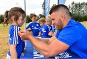 17 July 2018; Elisha Young, age 7, from Kiltegan, Co. Wicklow, has her jersey signed by Leinster's Sean O'Brien during the Bank of Ireland Leinster Rugby Summer Camp at Tullow RFC, in Roscat, Tullow, Co. Carlow. Photo by Seb Daly/Sportsfile