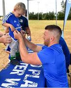 17 July 2018; Conan O'Brien, age 2, from Jersey, Channel Islands, has his jersey signed by his uncle, Leinster's Sean O'Brien, during the Bank of Ireland Leinster Rugby Summer Camp at Tullow RFC, in Roscat, Tullow, Co. Carlow. Photo by Seb Daly/Sportsfile