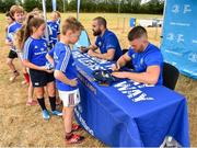 17 July 2018; Leinster's Scott Fardy and Sean O'Brien sign items for participants during the Bank of Ireland Leinster Rugby Summer Camp at Tullow RFC, in Roscat, Tullow, Co. Carlow. Photo by Seb Daly/Sportsfile