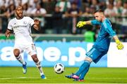 17 July 2018: Cork City goalkeeper, Peter Cherrie in action against Jose Kante of Legia Warsaw during the UEFA Champions League 1st Qualifying Round Second Leg match between Legia Warsaw and Cork City at the Polish Army Stadium in Warsaw, Poland. Photo by Lukasz Grochala/Sportsfile