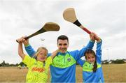 19 July 2018; Dublin hurler Danny Sutcliffe surprised youngsters, including Katie Brady, age 6, left, and Ruth Howard, age 6, taking part in one of the county's most popular Kellogg's GAA Cúl Camps with a visit to Éire Óg in Wicklow recently. Danny joined in what was an action-packed morning of activity and fun, teaching the children GAA skills, sharing great insider tips and promoting the importance of active play. More than 142,000 children took part in Kellogg's GAA Cúl Camps last year.  The camps are for children aged 6 – 13 years who can enjoy a week of on-the-pitch action learning new skills, making new friends, being active and having fun during the school holidays in July and August. Kellogg's involvement with Cúl Camps stems from its commitment to promoting and encouraging physical activity.  Educating children on the importance of nutrition to support active play is a key component of Cúl Camps and Kellogg's believes in the power of breakfast to fuel activity both on and off the pitch. The camps are in full swing and surprise visits will take place across all provinces during the summer. For more information parents can log on to www.kelloggsculcamps.gaa.ie Photo by Stephen McCarthy/Sportsfile